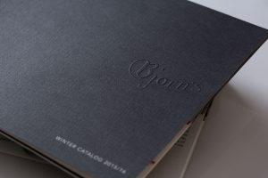 emboss | specialty paper | white ink